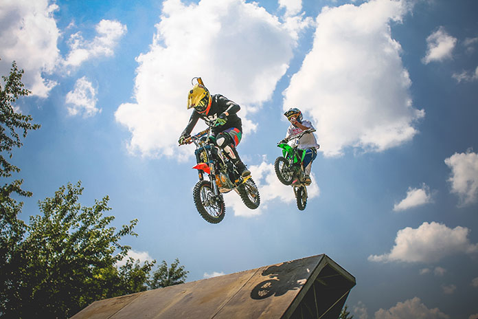 two-crazy-jumping-pitbikers-picjumbo-com
